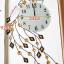 นาฬิกาติดผนังคริสตัลนกยูงเงินแสนสง่า ขนาด 24*46*92 cm. thumbnail 5